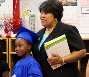 Guardian Angel Teacher Laytina James with a pre-school graduate.