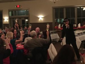 Audience enjoying a dinner theater performance