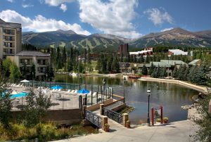 View of the Hyatt resort in Breckenridge, Colorado showing a lake and mountains