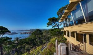 Deck jutting out over the rocky shoreline in Carmel