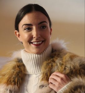 Model at 2017 Eleganza wearing a turtleneck sweater and fur vest