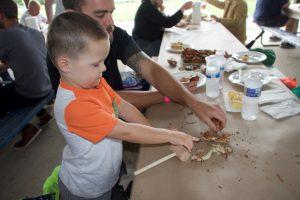 Participants eating crabs
